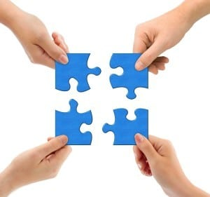 image of 4 jigsaw pieces being connected