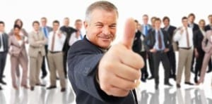 Image of a business man giving the thumbs-up