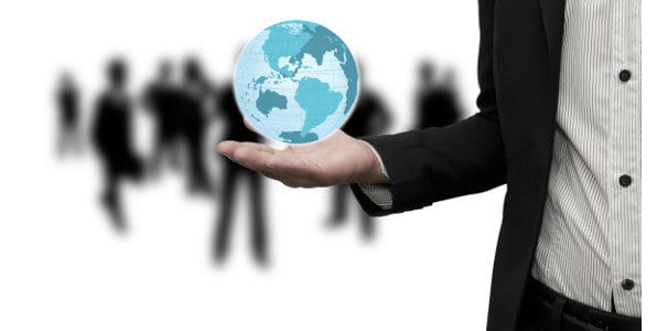 image of man holding a globe in his hand