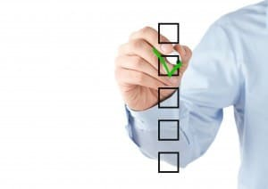 image of a businessman adding a tick to a social media checklist
