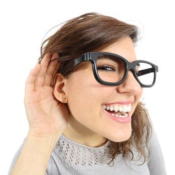 a woman listening to social media