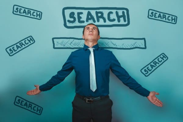 businessman and word search